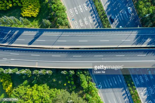 road junction aerial view - liyao xie stock pictures, royalty-free photos & images