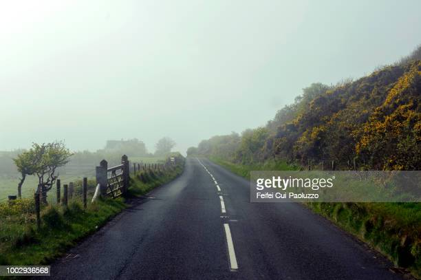 road landscape near ballycastle, northern ireland - northern ireland stock photos and pictures