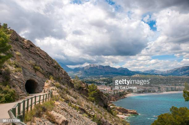 road leading from el faro lighthouse, serra gelada natural park, albir, alicante, spain. - alicante stock pictures, royalty-free photos & images