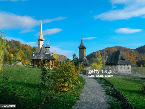road leading to church - lutai razvan stock pictures, royalty-free photos & images