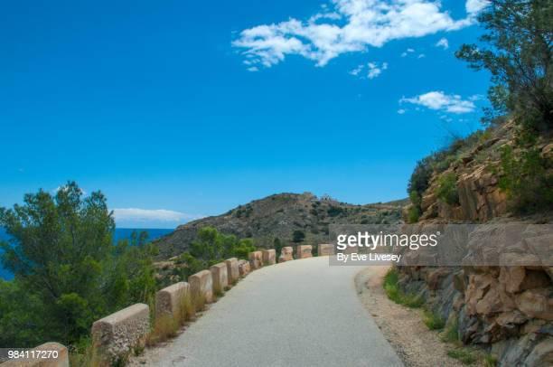 road leading to el faro lighthouse, serra gelada natural park, albir, alicante, spain. - alicante fotografías e imágenes de stock