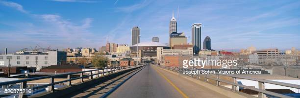 road leading to indianapolis skyline - indianapolis stock pictures, royalty-free photos & images