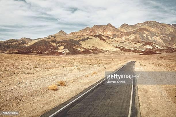 road leading to mountain range