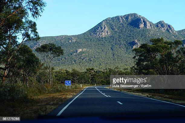 Road Leading To Mountain Seen From Car Windshield
