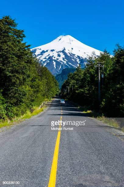 Road leading to the snowcapped volcano Villarrica, Pucon, southern Chile, Chile