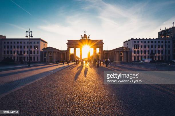 Road Leading Towards Brandenburg Gate Against Sky During Sunset