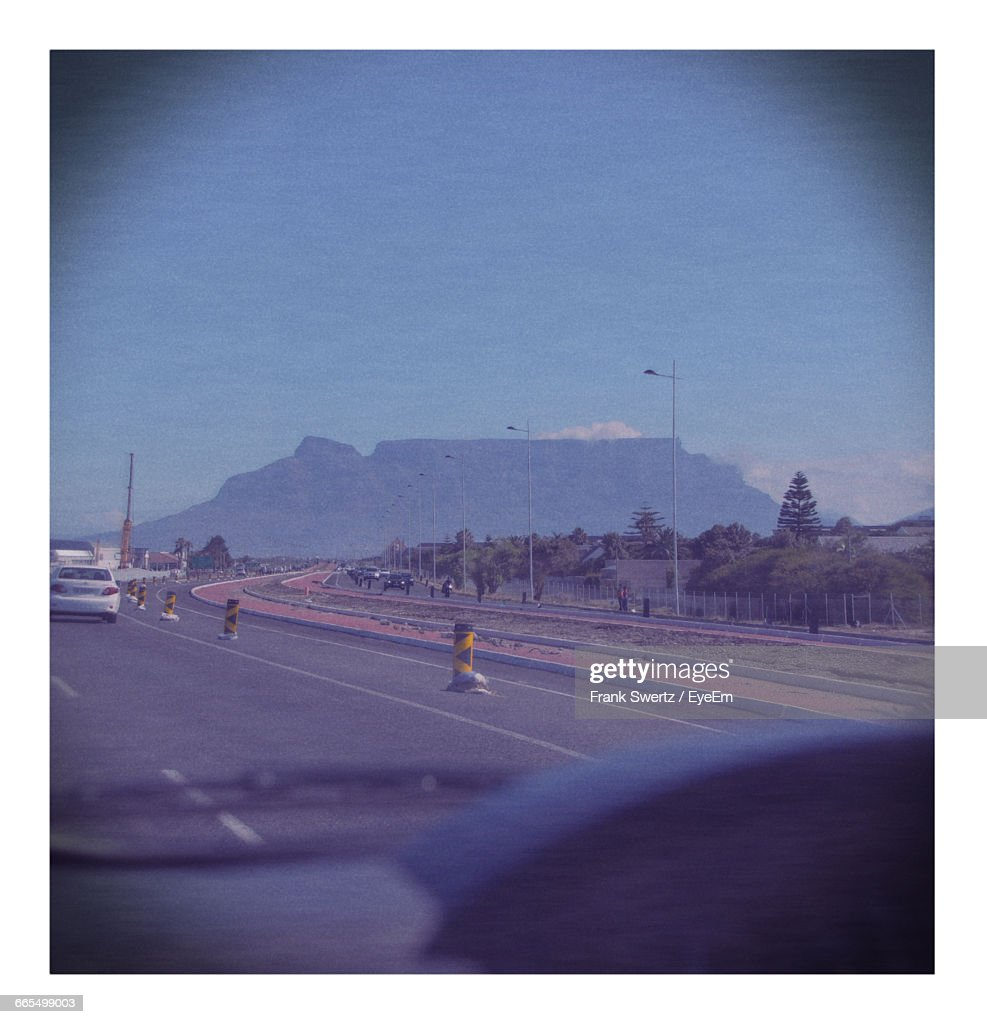Road Leading Towards Mountain Against Sky Seen Through Car Windshield : Stock-Foto