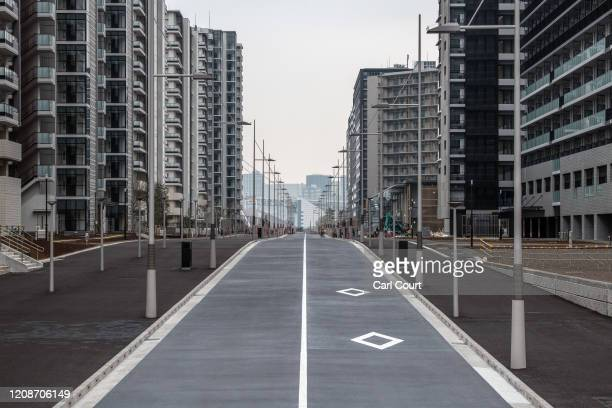 Road leads through the Tokyo 2020 Olympics Athletes Village on March 31, 2020 in Tokyo, Japan. The Athletes Village, designed to accommodate around...