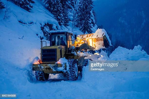 Road Machine Digger in snow,Xinjiang,China.