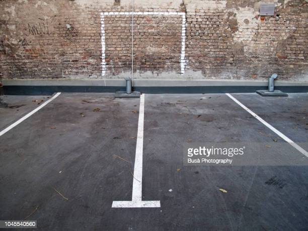 road marking in an empty parking lot in berlin, germany - ゴールポスト ストックフォトと画像
