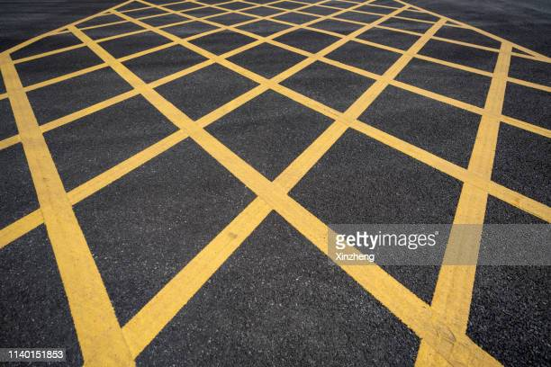 road marking - dividing line road marking stock pictures, royalty-free photos & images