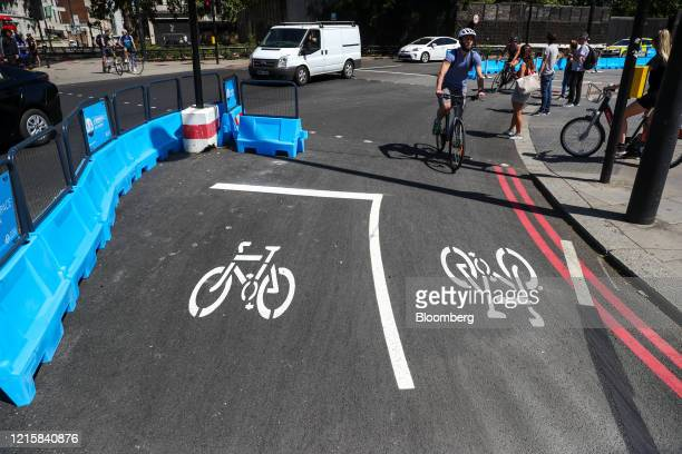 Road marking sits in a new bicycle lane created by Transport for London on Park Lane in London, U.K., on Thursday, May 28, 2020. To get London moving...