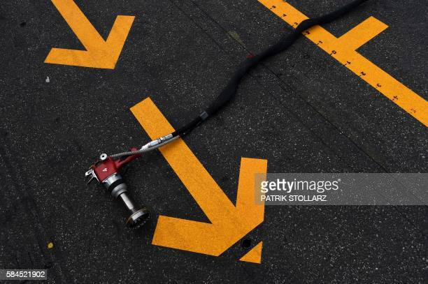TOPSHOT Road markings are seen on the tarmac of the pit lane during the first practice session of the Formula One German Grand Prix at the Hockenheim...
