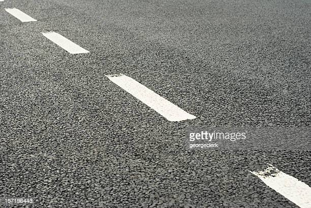 road markings: dividing line - dividing line road marking stock pictures, royalty-free photos & images
