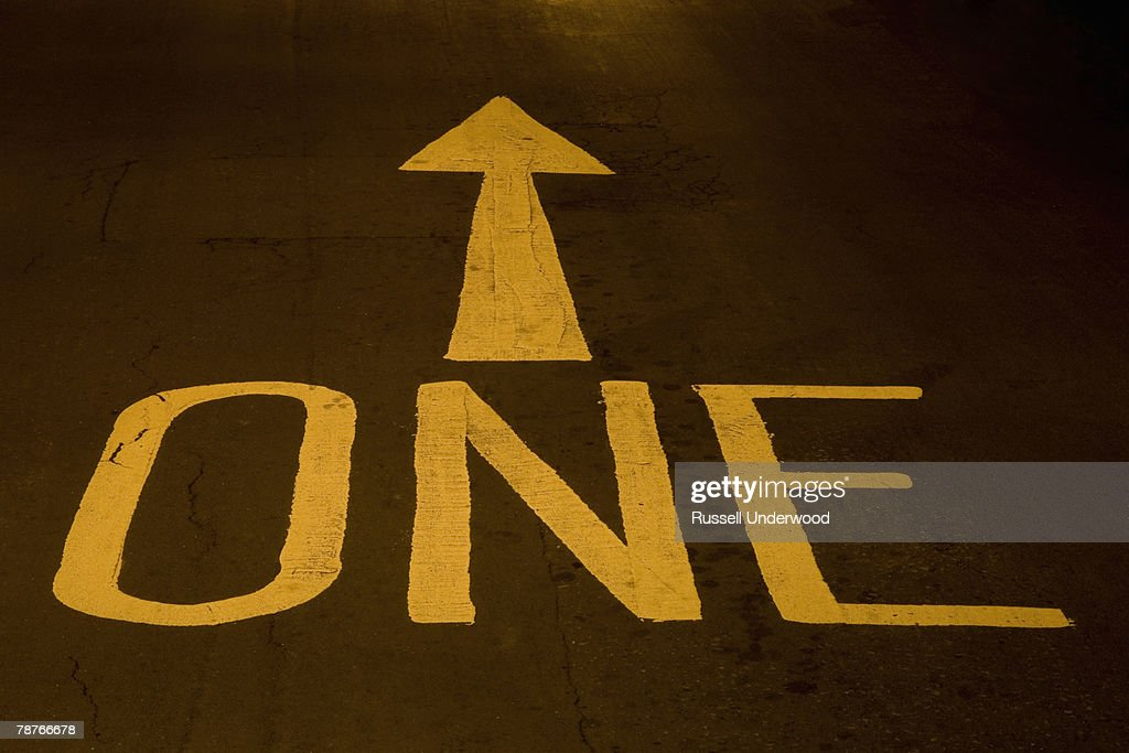 Road markings on a one-way street : Stock Photo