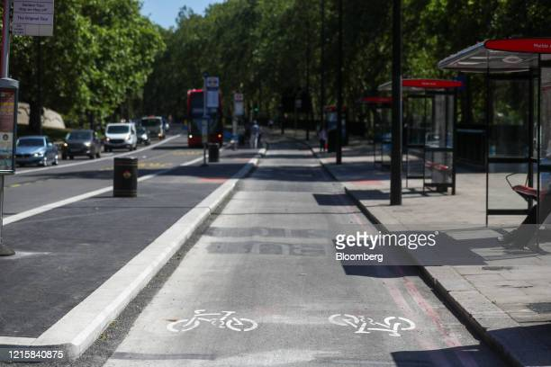 Road markings sits in new bicycle lane, converted from a section of bus lane, by Transport for London on Park Lane in London, U.K., on Thursday, May...