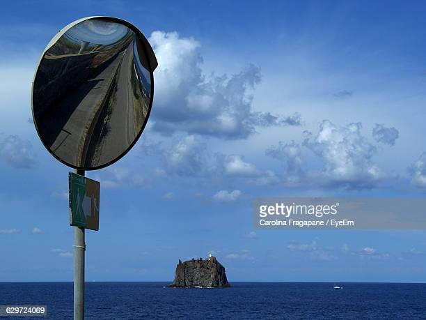 road mirror by sea against sky - carolina fragapane stock pictures, royalty-free photos & images