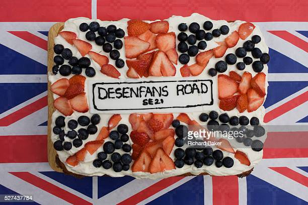 Road name on decorated sponge cake at a neighbourhood street party in Dulwich south London celebrating the Diamond Jubilee of Queen Elizabeth A few...