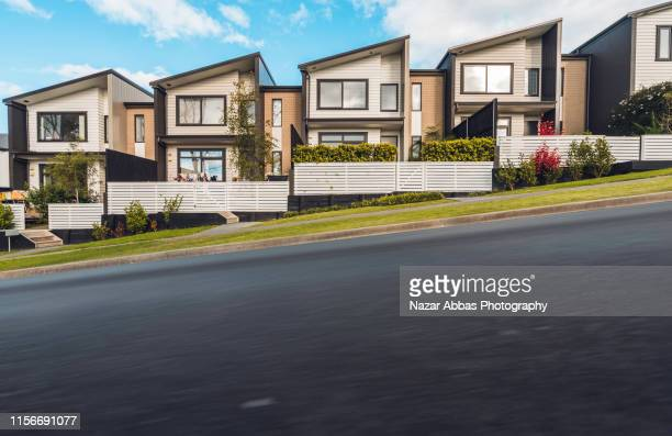 road next to houses. - community building stock pictures, royalty-free photos & images