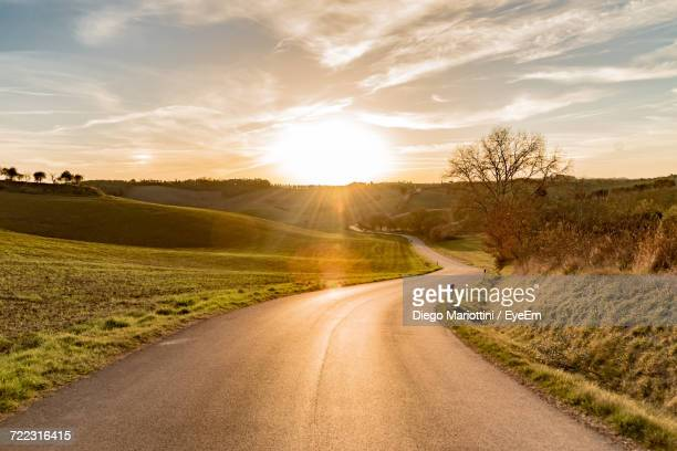 Road On Landscape Against Sky During Sunset
