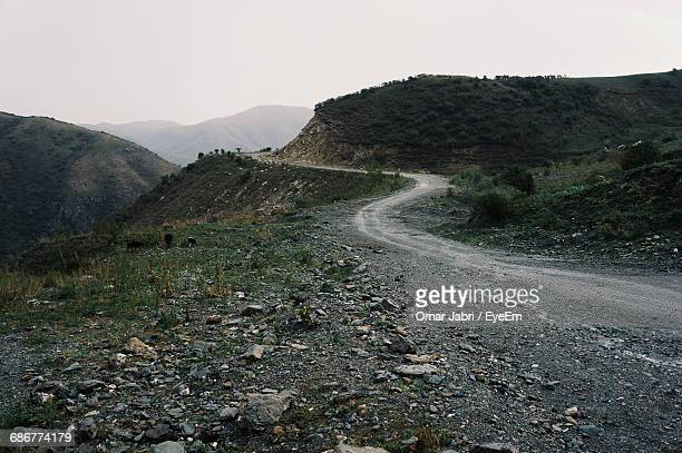 road on mountain against sky - mountain road stock pictures, royalty-free photos & images