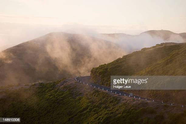 road on mountains of paul da serra plateau at sunset. - hochplateau stock-fotos und bilder