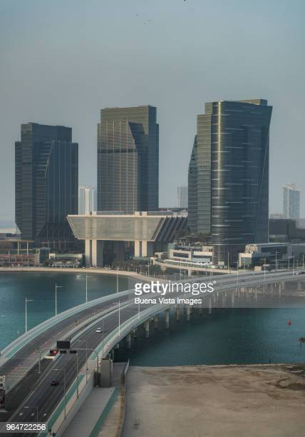 Road over water connecting to futuristic skyscrapers