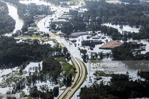 A road partially covered by floodwater is seen in this aerial photograph taken above Kinston North Carolina US on Friday Sept 21 2018 Record floods...