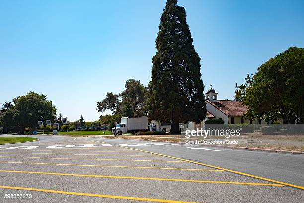 A road passes by a Spanish Colonial Revival style building on a sunny day within the secure area of the NASA Ames Research Center campus in the...