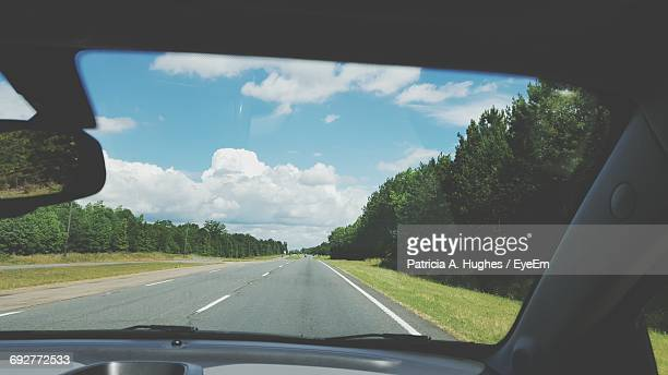 Road Passing Through Car Windshield