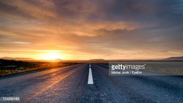 Road Passing Through Landscape During Sunset