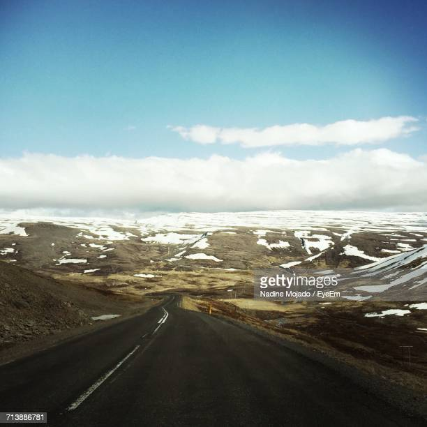road passing through landscape - mojado stock pictures, royalty-free photos & images