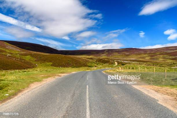 road passing through landscape - inverness stock photos and pictures