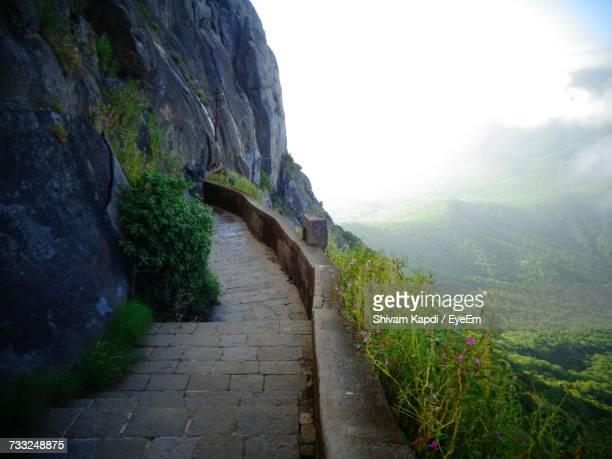 road passing through mountain - junagadh stock photos and pictures
