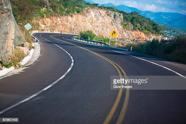 road passing through mountains, san luis potosi, mexico - curved arrows stock photos and pictures