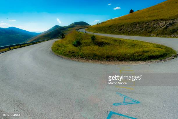 road - hairpin curve stock photos and pictures
