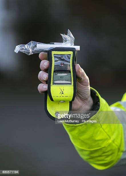 Road Policing officer holds an operational breathalyser during a random drink driving checkpoint in Belfast A drunk mother doing the school run after...