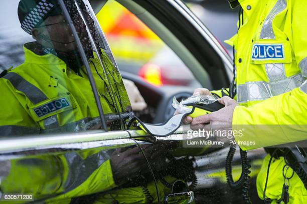 Road Policing officer prepares a breathalyser test during a random drink driving checkpoint in Belfast A drunk mother doing the school run after a...