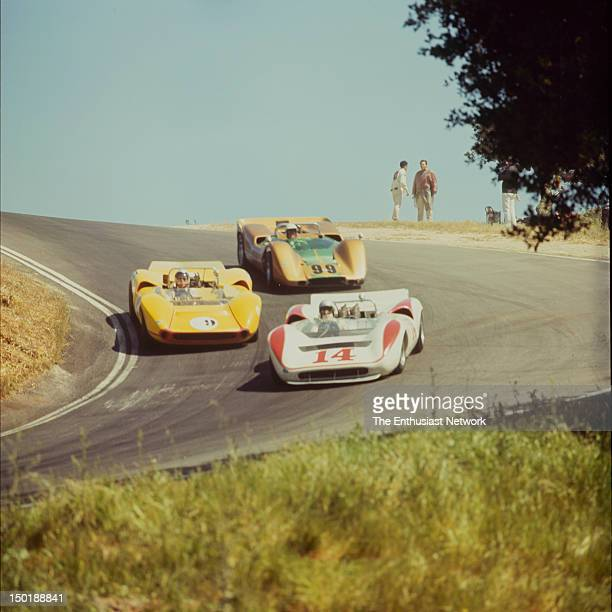 Road Racing Championships USRRC Laguna Seca Bud Morley in his Lola T70 leads Bill Young also in a T70 and Moises Solana in a McLaren M6B