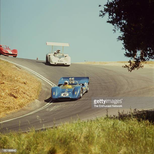 Road Racing Championships USRRC Laguna Seca Mark Donohue in his McLaren M6A and Jim Hall in his Chaparral 2G drive through the corkscrew