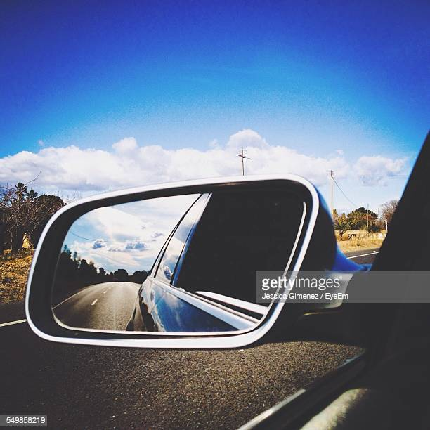 road reflecting on side-view mirror - side view mirror stock photos and pictures