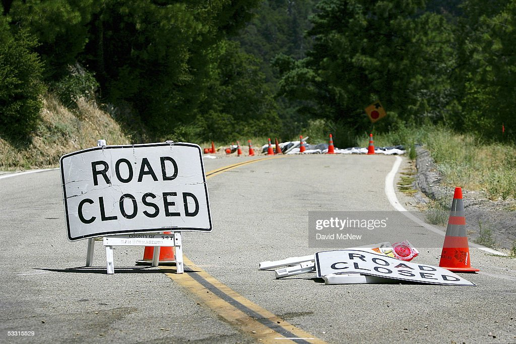 A road remains closed since last winter's record rains on August 1, 2005 in Running Springs, east of Lake Arrowhead, California. Last winter was one of the wettest on record, dropping 90 inches of rain in some southern California mountain areas and creating the thickest vegetation growth in memory, and damaging more than 2,000 miles of fire access roads used to protect 2.3 million acres of forests. In addition to the many thousands of trees killed by a massive pine beetle infestation, newly grown vegetation is drying up under triple-digit temperatures and raising fears of a repeat of the devastating fire season of 2003. President Bush signed an emergency funding bill in May allocating $25 million to fix roads in southern California?s national forests but Congress has acted slower than expected in providing the money so some of the repairs might not be done until October.