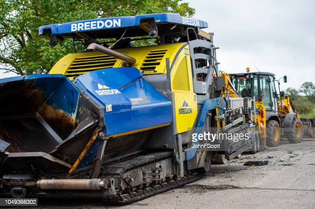 Road repair machinery parked in a lay-by