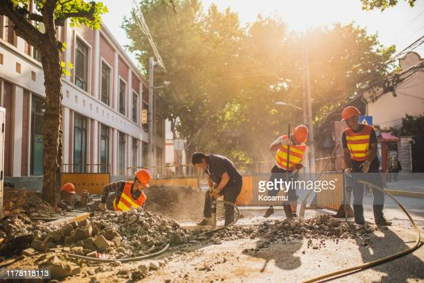 road repairing in shanghai city street - barricade stock pictures, royalty-free photos & images