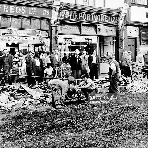 Road repairs in Portobello Road London c1956