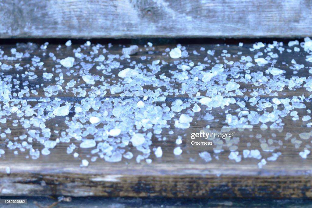 Road Rock Salt on Wooden Stair Step Close Up Abstract : Stock Photo
