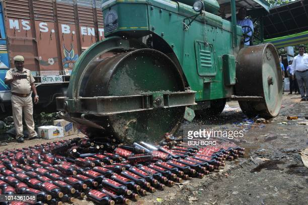 A road rollercrushes crushes liquor bottles which were seized by the sleuths of the department for illegal trading in Guwahati on August 10 2018 More...