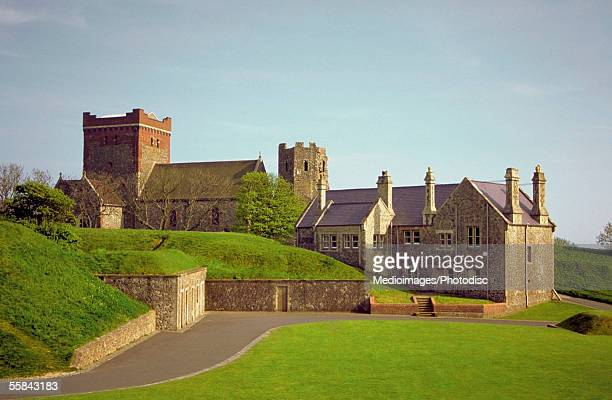 Road running through a grass area in front of the Dover Castle, Kent, England
