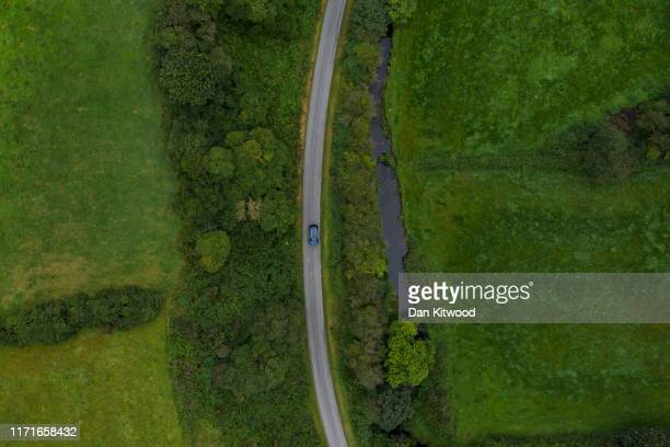 A road runs along a stream that marks the border between Northern Ireland and Ireland on August 29 2019 in Castleblayney Northern Ireland The...