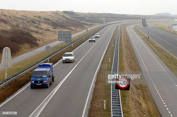 A road runs parallel to a sand dune dike in Zeeland The NetherlandsTuesday January 10 2006